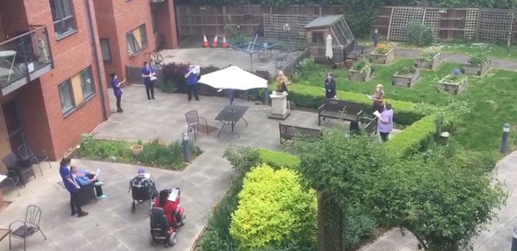 Care Support staff and service users enjoying some fun outside